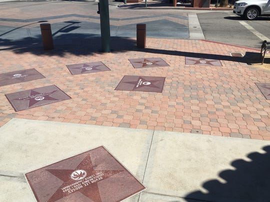 A constellation of star markers in front of the Welwood-Murray Memorial Library in downtown Palm Springs. The star markers are part of the Palm Springs Walk of Stars, which honor note-worthy individuals with a connection to Palm Springs.