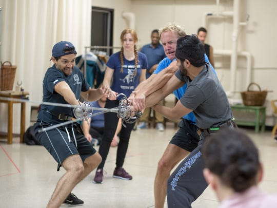 """As Emily Trask watches in the background, (from L) Bari Robinson, David Whalen and Taha Mandviwala take part in a fight rehearsal during preparation for the Playhouse in the Park's season-opening production of """"Shakespeare in Love."""""""