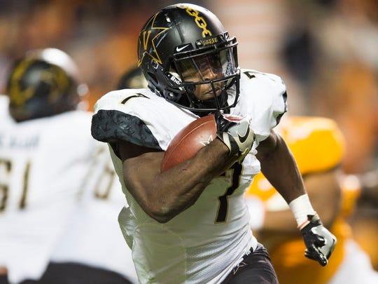 Vanderbilt running back Ralph Webb (7) runs the ball