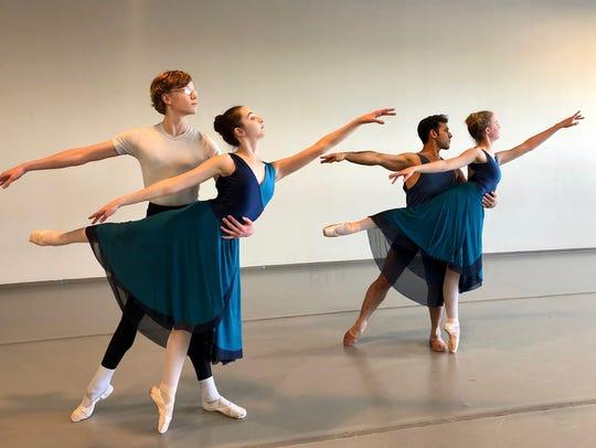 Four dancers of the Wichita Falls Ballet Theatre preparing