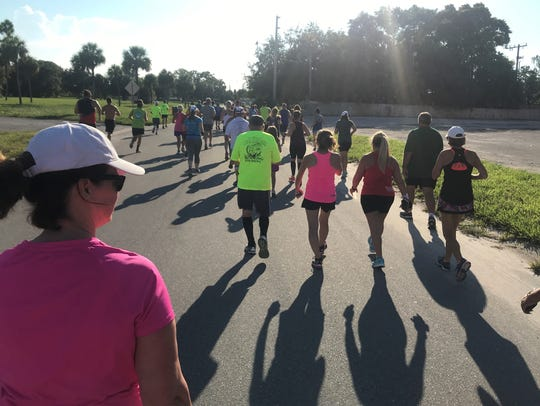 Runners and walkers head out on a three-mile course