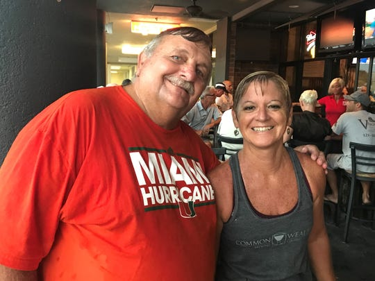 Bob and Lisa Rykaczewski of Satellite Beach may have gotten soaked at last week's run at Charlie & Jake's in Suntree, but they were still all smiles.