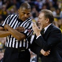Michigan State Spartans head coach Tom Izzo  talks to referee Ted Valentine during the game against the Michigan Wolverines at Crisler Center.