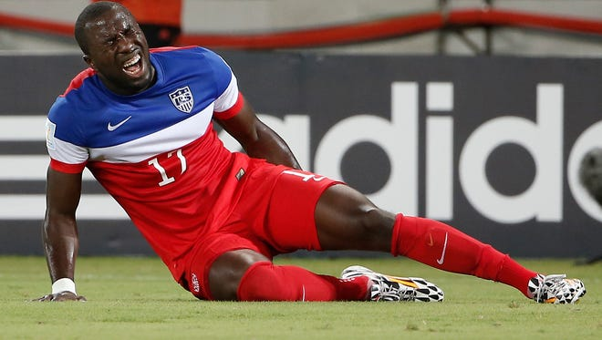 United States forward Jozy Altidore grabs his leg in pain while falling to the ground during the first half of Monday's 2014 World Cup win against Ghana at Estadio das Dunas.