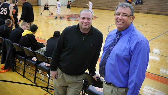 St. Cloud Tech head boys basketball coach Mike Trewick Jr. (left) and his father, Mike Trewick Sr. (right), get together before  Tech's game against Wayzata in 2013. Mike Trewick Sr. was the principal at Wayzata. Mike Trewick Jr. is the president of the Minnesota Boys Basketball Coaches Association.