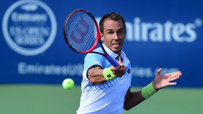 Lukas Rosol of Czech Republic returns a shot from Ernests Gulbis of Latvia during the first day of the Winston-Salem Open.