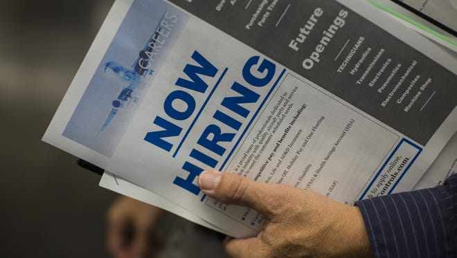 David Ryder, Bloomberg About 2.7 million people quit jobs in September; that rate has held steady for a year. A job seeker holds informational handouts from recruiters during a job fair in Seattle, Washington, U.S., on Tuesday, Oct. 6, 2015. The U.S. Department of Labor is scheduled to release initial jobless claims figures on October 8. Photographer: David Ryder/Bloomberg ORG XMIT: 583988657