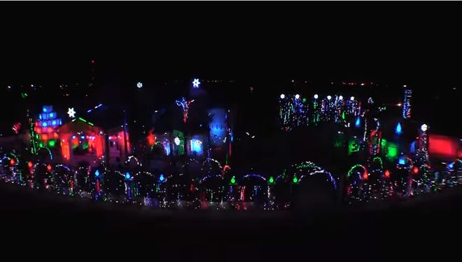 The annual Christmas Lights Show at the Fred Loya house is seen.