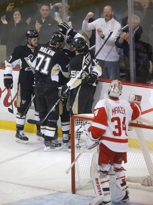 The Pittsburgh Penguins celebrate a goal by Patric Hornqvist behind Detroit Red Wings goalie Petr Mrazek (34) in the first period of an NHL hockey game, Wednesday, Feb. 11, 2015 in Pittsburgh.
