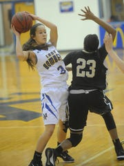 Mountain Home's Alivia O'Brien, left, looks to pass over Little Rock Central's Bre Amber Scott (23) during the Lady Bombers' xx-xx loss at The Hangar.