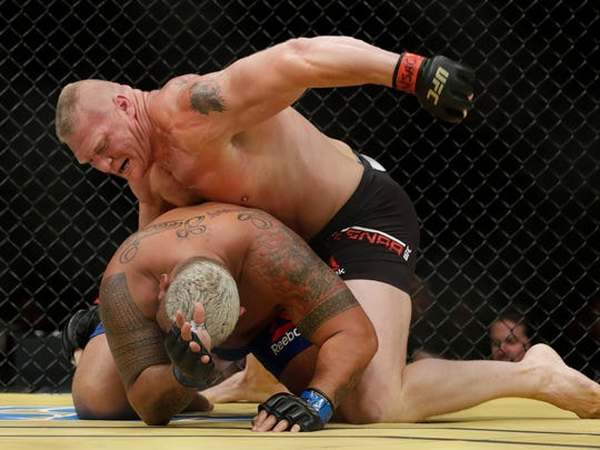 Brock Lesnar, top, fights Mark Hunt during their heavyweight mixed martial arts bout at UFC 200, Saturday, July 9, 2016, in Las Vegas. (AP Photo/John Locher)