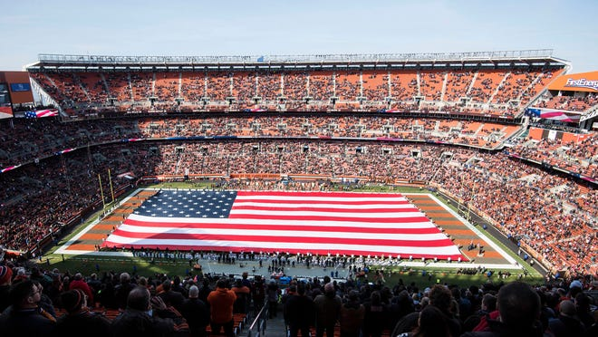 Nov 11, 2018; Cleveland, OH, USA; The American flag is unfurled before the game for the national anthem between the Cleveland Browns and the Atlanta Falcons at FirstEnergy Stadium. Mandatory Credit: Ken Blaze-USA TODAY Sports