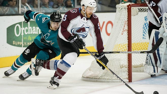 Colorado Avalanche defenseman David Warsofsky (5) keeps the puck away from San Jose Sharks right wing Joonas Donskoi (27) during the second period at SAP Center at San Jose on April 5, 2018.
