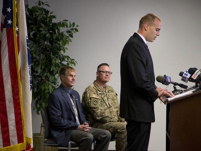 Jacob Conrad, speaks during a press conference at the