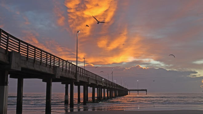 December's winter storms played out dramatically above the Gulf of Mexico and Bob Hall Pier.