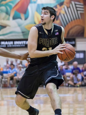 Purdue guard Dakota Mathias looks for a teammate to pass to in the second half of an NCAA college basketball game at the Maui Invitational on Monday, Nov. 24, 2014, in Lahaina, Hawaii. Kansas State beat Purdue 88-79. (AP Photo/Eugene Tanner)