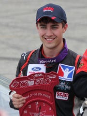 Seymour's Ty Majeski poses in victory lane after winning the Joe Shear Classic at Madison International Speedway earlier this month. Majeski has signed on with Roush-Fenway Racing in its Driver Development program.
