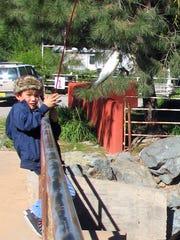 Johnny Alvarado, 7,  from El Paso hauls in a trout