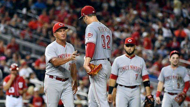 Cincinnati Reds interim manager Jim Riggleman (35) removes starting pitcher Matt Harvey (32) during the fifth inning at Nationals Park.