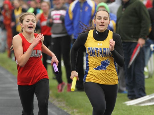 Ontario's Rachel Miller passes Shelby's Makenna Heimlich at the finish line to win the 4x400-meter relay at the 2016 Northern Ohio League meet.