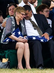 Barbara Annechino of Irondequoit is comforted by brother