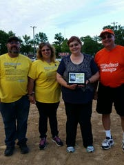 (From left) George and Angel Mueller, Debbie Collard and Al Klimet. Collard and Klimet are representatives of Mishicot Youth Sports, which purchased an adult dose and a youth dose of epinephrine. The Muellers donated money from the Dillon Mueller Memorial Fund to assist with the purchase of the life-saving medicine.