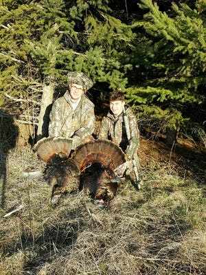 Pictured, from left: father and son team, Clint and Jacob Rau, were mentored by Andy Pantzlaff during Maribel Sportsmen's Club's Learn to Turkey Hunt program. These first-time turkey hunters show the turkeys they bagged within minutes of each other from the same blind.