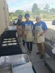 Students from Lynn Middle School help out a Kiwanis