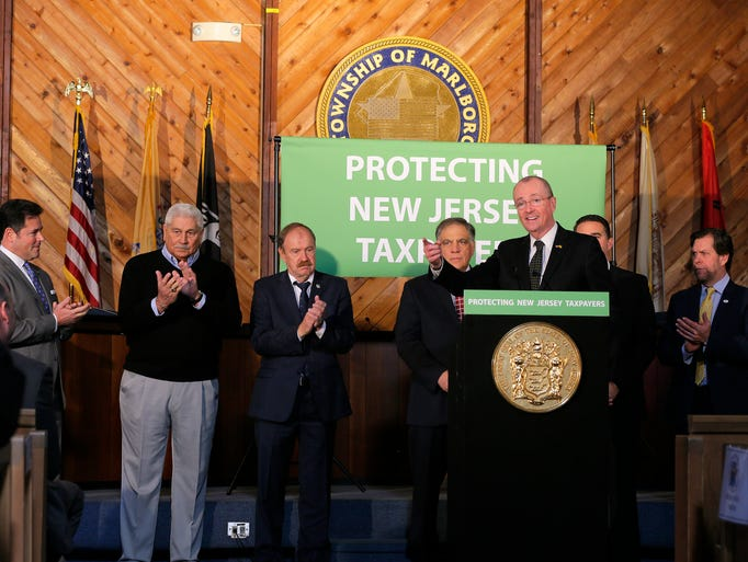 Governor Phil Murphy announces, surrounded by local