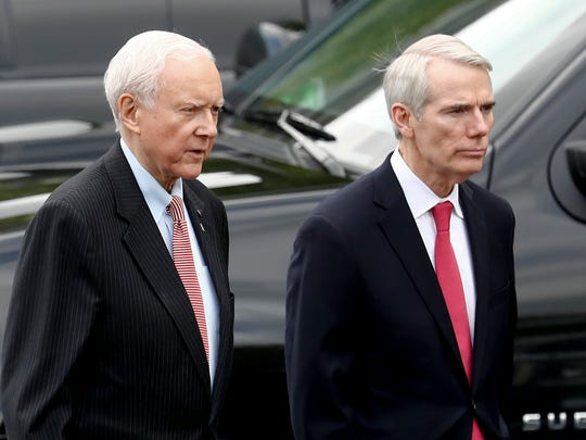 Sen. Rob Portman, right, walks alongside Sen. Orrin