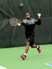 Lakota East's Chris Holden makes it court's edge for a forehand return at the Coaches Classic,  April 30.