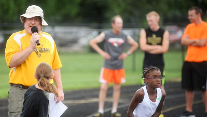 Mike Gray makes announcements during the 10th annual Black Bear Summer Track and Field meet.