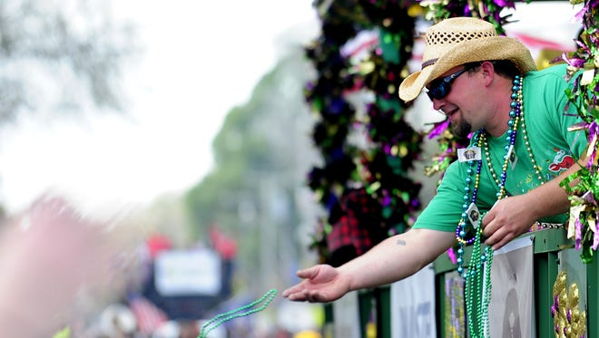 Acadiana residents celebrate Mardi Gras with the Youngsville Mardi Gras parade  in Youngsville, LA, Saturday, March 1, 2014.