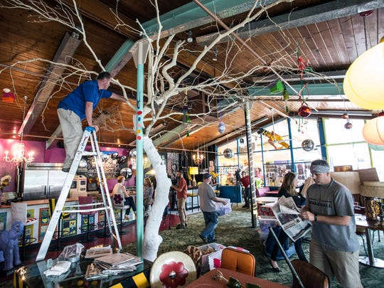 The landmark indoor tree that set the tone for the decor at Lynn's Paradise Cafe is dismantled after the announcement that the building on Barrett Avenue had been sold. 3/24/16