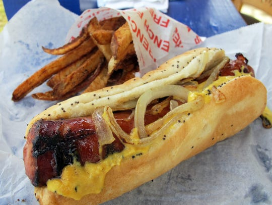 A Maxwell Street Polish and fries at Lucky Dawgs 2, a Chicago-style hot dog stand that recently opened at 12435 Collier Blvd., just south of Green Boulevard in Golden Gate.