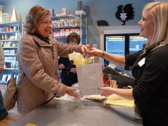 Brenda Favero, of Lakeport reaches for her purchase
