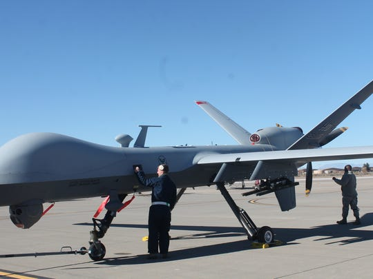 Airmen at Holloman Air Force Base prepare the MQ-9 to help Santa with his Christmas Eve journey delivering presents.