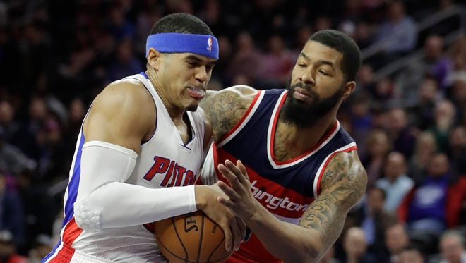 Wizards forward Markieff Morris reaches in on Pistons forward Tobias Harris during the first half Saturday, Jan. 21, 2017 at the Palace.