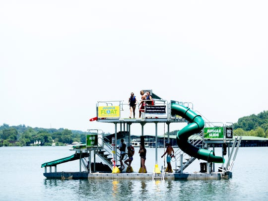 A view of the Jungle Float in Rocky Point Park in Farragut, Tennessee on Thursday, June 7, 2018. Jungle Float is a floating 35-foot water park featuring a rope swing, two launching trampoline platforms, a diving board, a high-jump platform, and a water slide.