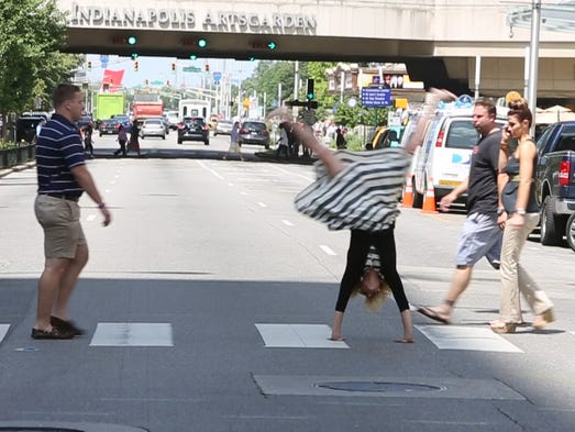 Amanda Kingsbury does a cartwheel in the streets of Downtown Indianapolis.