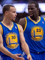 12-16-stephen-curry-draymond-green-warriors