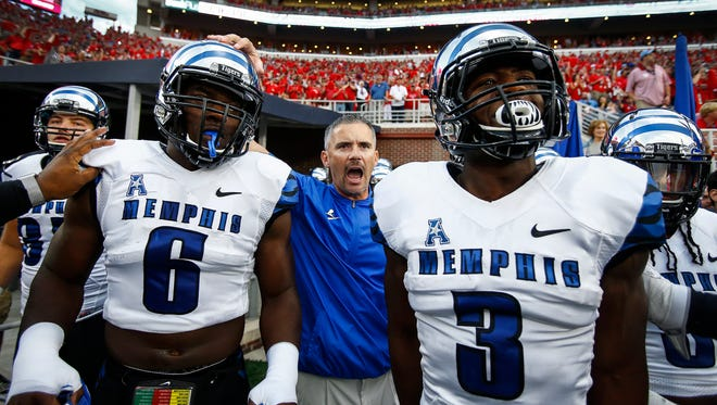 Oct. 1, 2016 - University of Memphis head coach Mike Norvell (middle) and his Tigers prepare to take the field for action Ole Miss at Vaught-Hemingway Stadium in Oxford, Miss.
