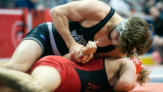South Western's Ethan Baney works on top against Reading's Quinn Foley during a 160-pound bout, at the District 3 Class 3A wrestling tournament at the Giant Center in Hershey, Thursday, Feb. 22, 2018.