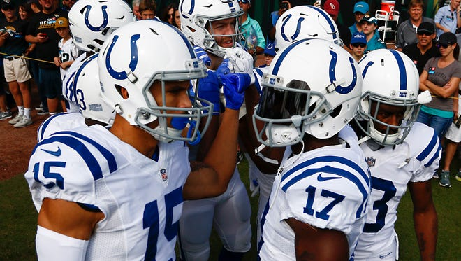 Indianapolis Colts receivers huddle up during pre game warmups before the game against the Jacksonville Jaguars at EverBank Field.