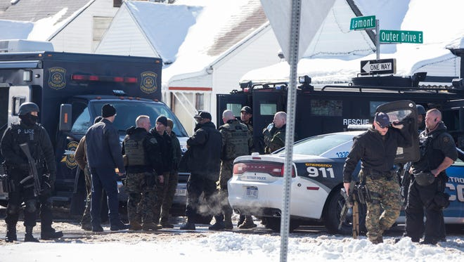 Law enforcement clear the scene of a fatal barricaded gunmen situation on Detroit's east side in 1900 block of Lamont Monday Feb. 12, 2018.