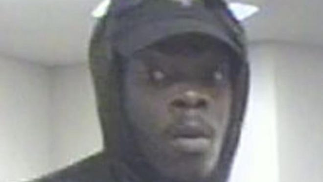 The FBI says this is Malcolm Lorenzo Jones in a surveillance video still from the May 22, 2017 robbery at a Key Bank branch in Colerain Township.