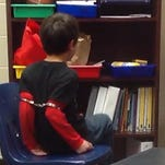 The ACLU's website shows an 8-year-old with handcuffs around his arms. The ACLU has sued the Kenton County Sheriff's Office and a deputy over the restraint.