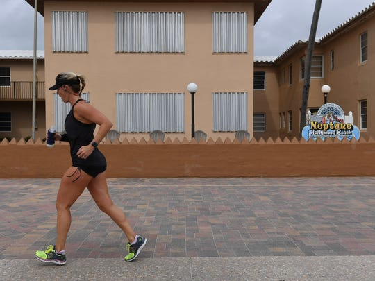 A runner gets in a workout in Hollywood, Florida, as the hurricane approaches the Florida coast.