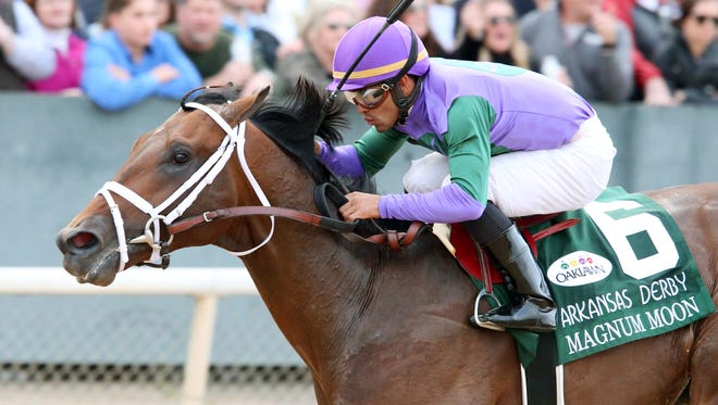 Magnum Moon and jockey Luis Saez win the Arkansas Derby on April 14 at Oaklawn Park in Hot Springs, Ark.