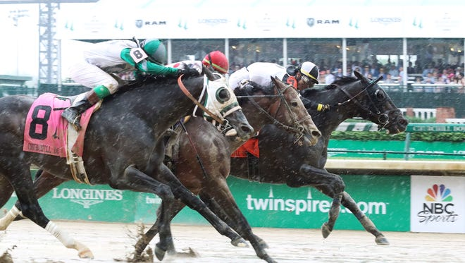 Limousine Liberal, back, wins the Grade 2 Churchill Downs Stakes in Louisville, Kentucky, on Saturday, May 5, 2018. Awesome Slew, middle, finished third. Warrior's Club, left, came up short by a head to finish second.